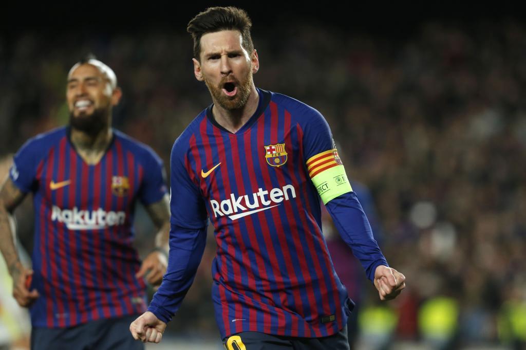 Lionel Messi celebrates scoring against Lyon in the 2018/19 Champions...