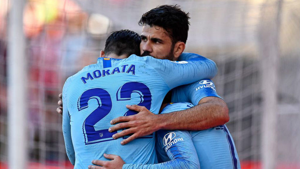 Morata, Diego Costa y Griezmann celebran un gol.