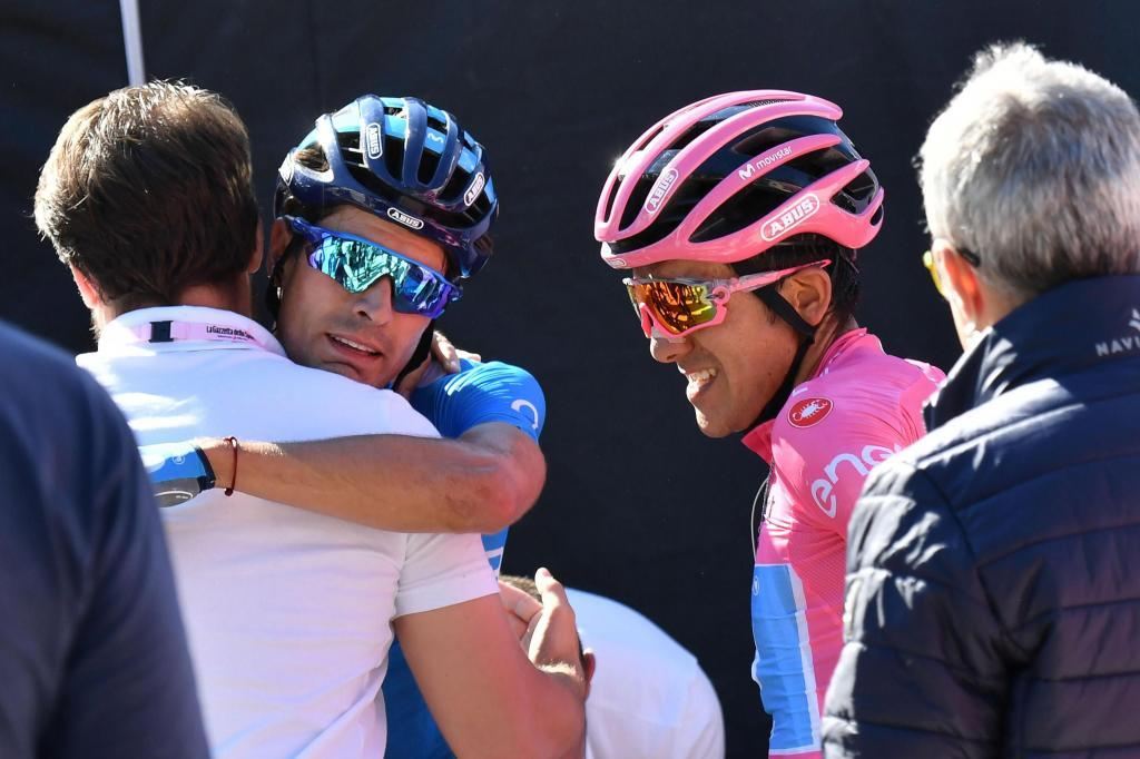 GRAFCVA5205. Croce Daune-monte Avena (Italy), 01/06/2019.- Ecuadorian cyclist Richard Carapaz (R) and Spanish cyclist Mikel <HIT>Landa</HIT> (C) of Movistar Team react after finishing the 20th stage of the Giro dItalia cycling race, over 194 km from Feltre to Croce dAune-Monte Avena, Italy, 01 June 2019. (Ciclismo, Italia) EFE/EPA/ALESSANDRO DI MEO
