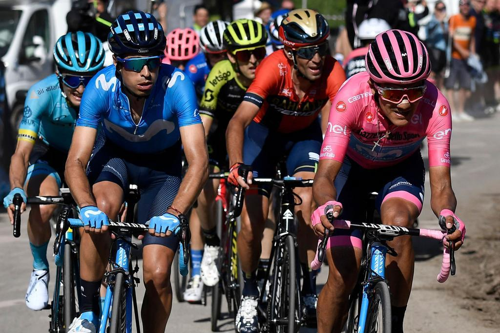 Team Movistar rider Ecuadors Richard Carapaz (R), wearing the overall leaders pink jersey, takes a relay from fellow teammate Spains Mikel <HIT>Landa</HIT> (L) during the Monte Evena final ascent in stage twenty of the 102nd Giro dItalia - Tour of Italy - cycle race, 194kms from Feltre to Croce DAune-Monte Avena on June 1, 2019. (Photo by Fabio Ferrari/LaPresse / POOL / AFP)