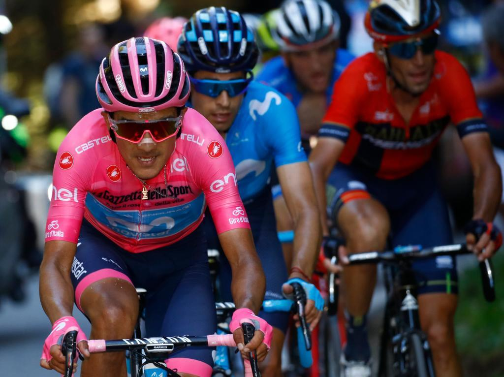 (From L) Team Movistar rider Ecuadors Richard Carapaz, wearing the overall leaders pink jersey, Team Movistar rider Spains Mikel <HIT>Landa</HIT>, and Team Bahrain rider Italys Antonio Nibali ride in the Monte Avena ascent during stage twenty of the 102nd Giro dItalia - Tour of Italy - cycle race, 194kms from Feltre to Croce DAune-Monte Avena on June 1, 2019. (Photo by LUCA BETTINI / POOL / AFP)
