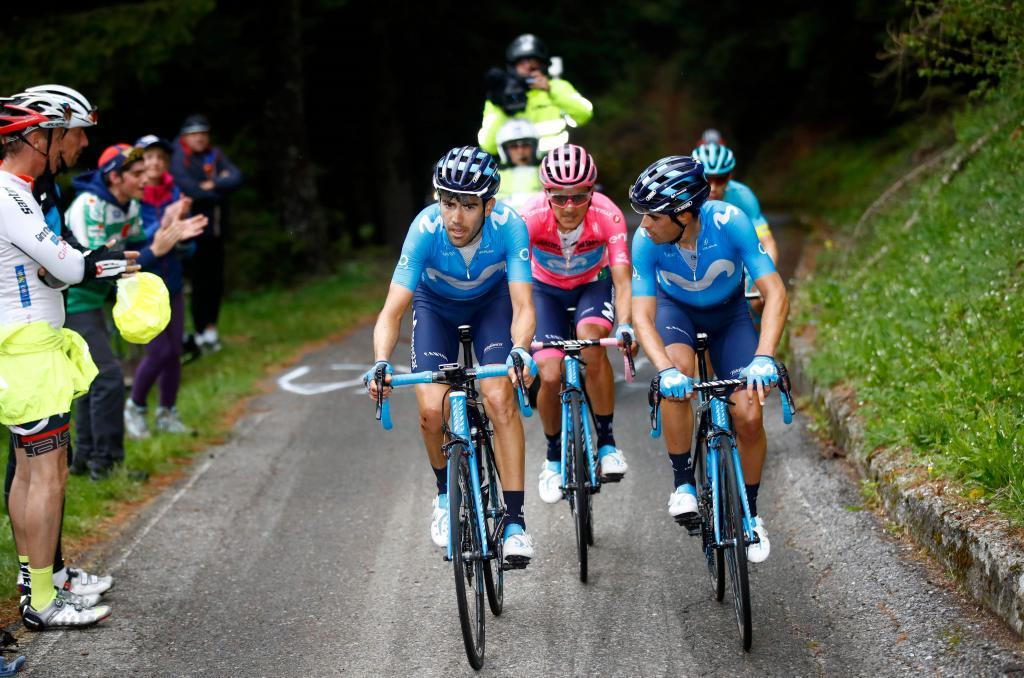 Team Movistar rider Spains Antonio Pedrero (L) climbs flanked by his teammate Team Movistar rider Spains Mikel <HIT>Landa</HIT> (R) ahead of Team Movistar rider Ecuadors Richard Carapaz (C), with the pink jersey of overall leader during the stage sixteen of the 102nd Giro dItalia - Tour of Italy - cycle race, 226kms from Lovere to Ponte Di Legno on May 28, 2019. (Photo by Luk BENIES / AFP)