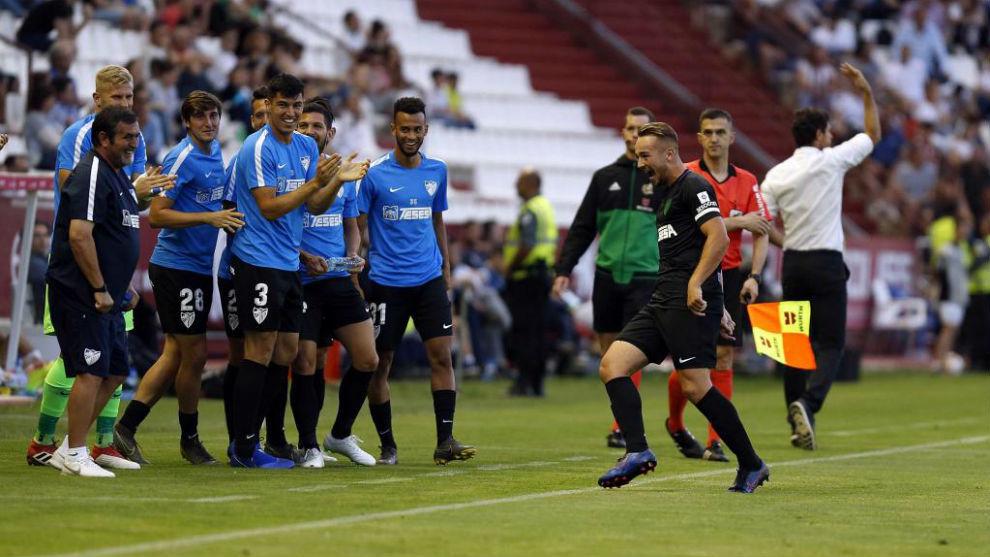 El Málaga celebra uno de sus goles ante el Albacete.