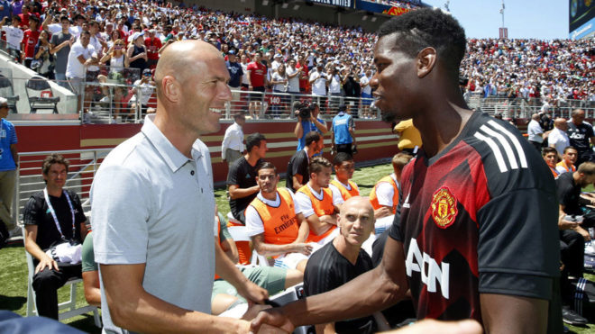 Zinedine Zidane greeting Paul Pogba during Real Madrid's USA tour in...