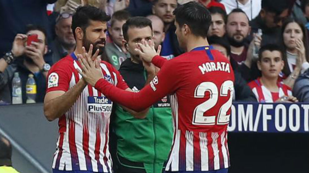 Alvaro Morata and Diego Costa during a substitution.