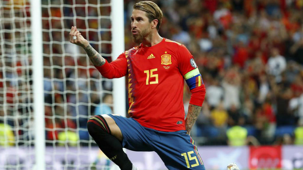 Sergio Ramos celebrates Spain's first goal after scoring from the...