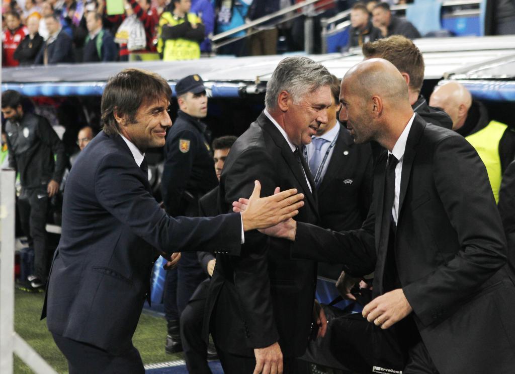 Antonio Conte greeting Zinedine Zidane.