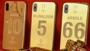 A personalised gold iPhone X will be given to each Liverpool player...