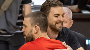 Pau and Marc Gasol greeting each other before an NBA game.