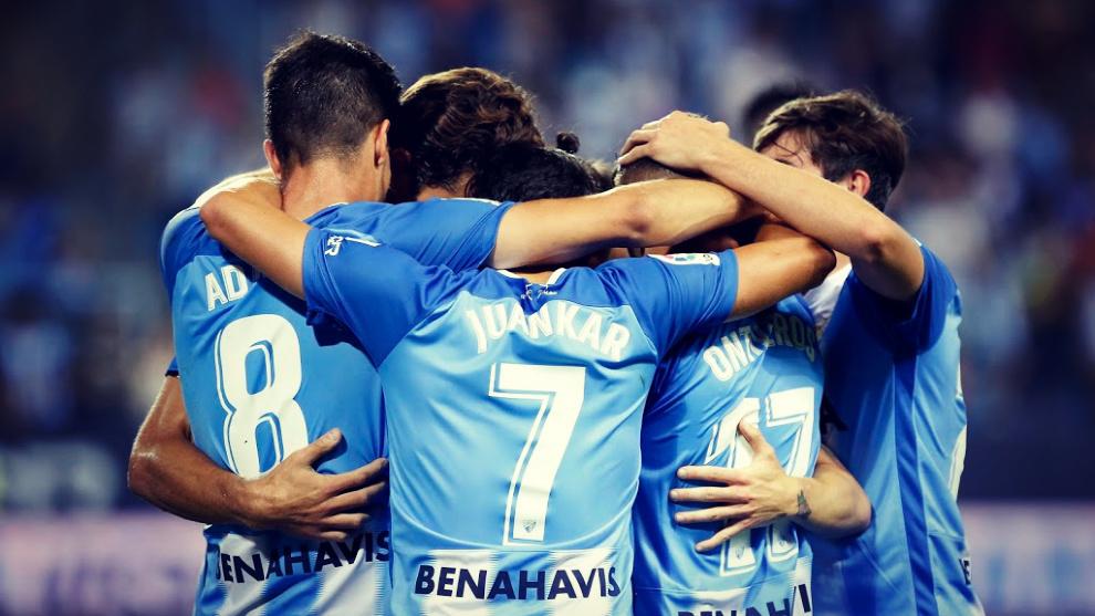 Los jugadores del Málaga celebran un gol en un partido en La...