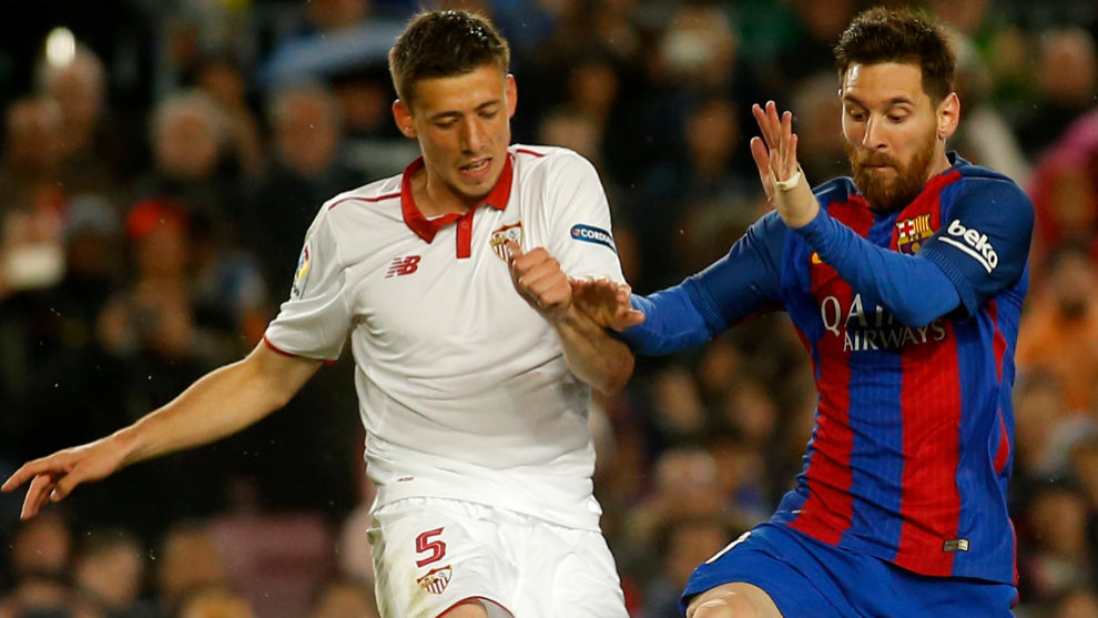 Lenglet battles with Messi during his time at Sevilla.