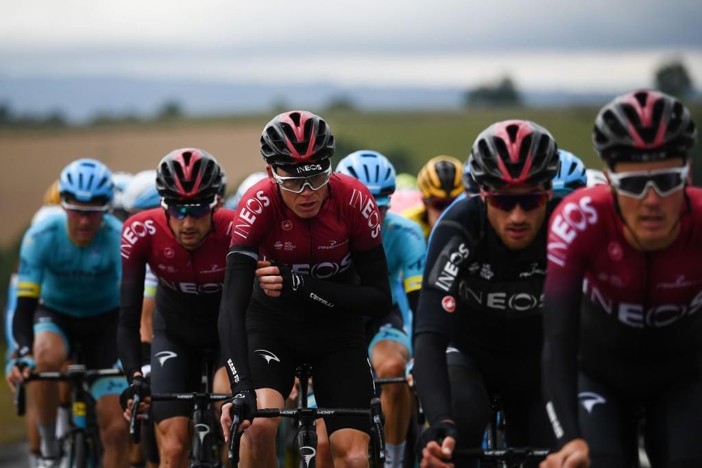 Team Ineos rider Great Britains Christopher <HIT>Froome</HIT> (C) rides during the second stage of the 71st edition of the Criterium du Dauphine cycling race, 180 km between Mauriac and Craponne-sur-Arzon on June 10, 2019. (Photo by Anne-Christine POUJOULAT / AFP)