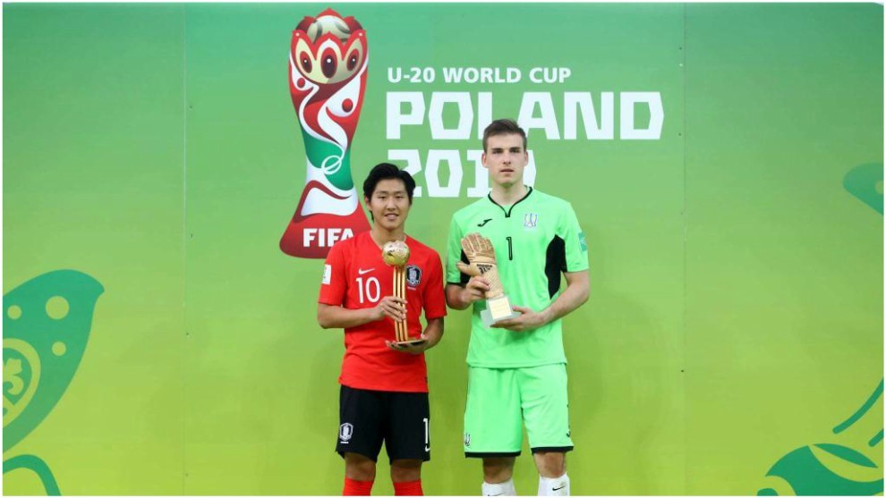 Kang-in Lee and Andriy Lunin with their individual awards after the...