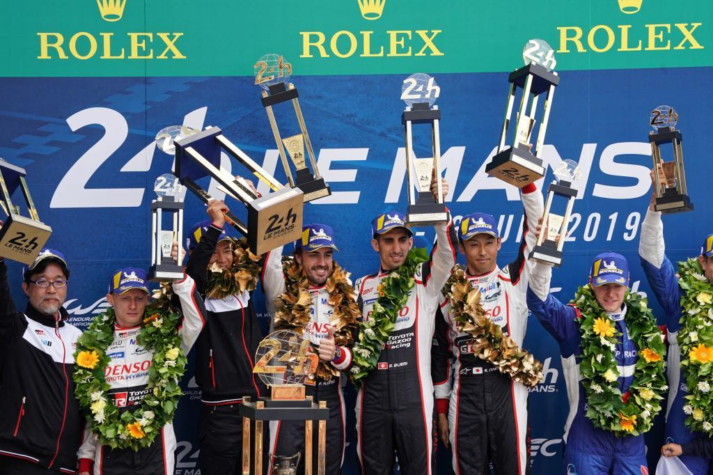 Le Mans (France), 16/06/2019.- Sebastien Buemi of Switzerland, Kazuki Nakajima of Japan and Fernando <HIT>Alonso</HIT> of Spain, drivers of Toyota Gazoo Racing (starting no.8) in a Toyota TS050 Hybrid celebrate on the podium after winning the Le Mans 24 Hours race in Le Mans, France, 16 June 2019. (Francia, Japón, España, Suiza) EFE/EPA/EDDY LEMAISTRE