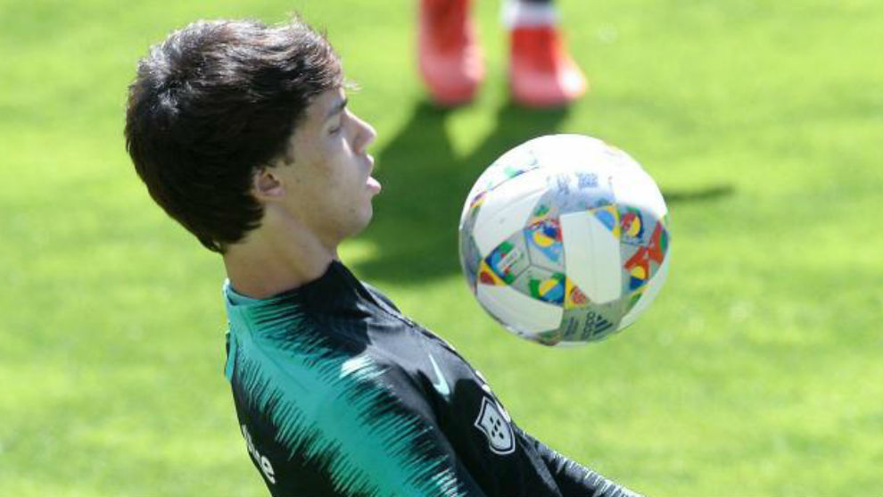 Joao Felix controlling the ball during a training session with...