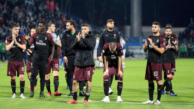 AC Milan applaud their fans.
