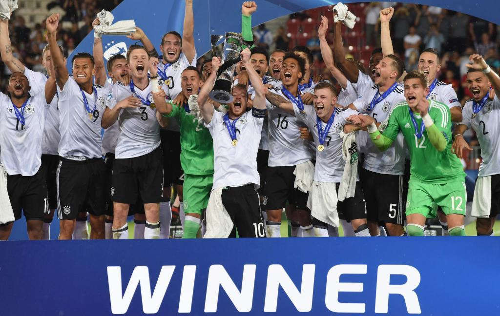 <HIT>Germany</HIT>s midfielder Maximilian Arnold (10) celebrates with the trophy and teammates after winning 1-0 the UEFA U-21 European Championship football final match <HIT>Germany</HIT> v <HIT>Spain</HIT> in Krakow, Poland, on June 30, <HIT>2017</HIT>. / AFP PHOTO / Janek SKARZYNSKI