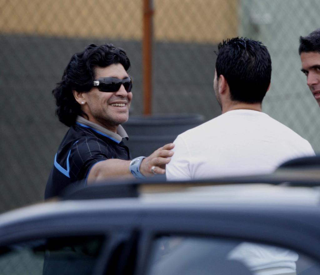 Diego Maradona greeting the late Jose Antonio Reyes.