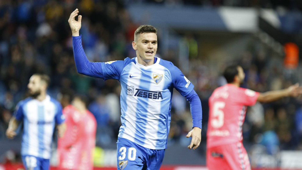 Jack Harper celebrating a goal for Malaga.