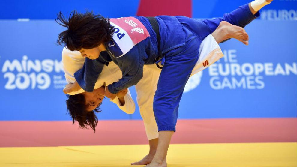 Julia Figueroa, de blanco, en el duelo por el bronce con la portuguesa...