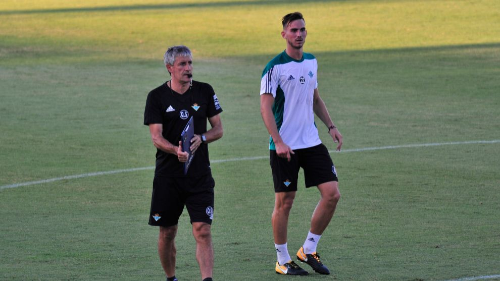 Quique Setien and Fabian Ruiz during a training session during their...