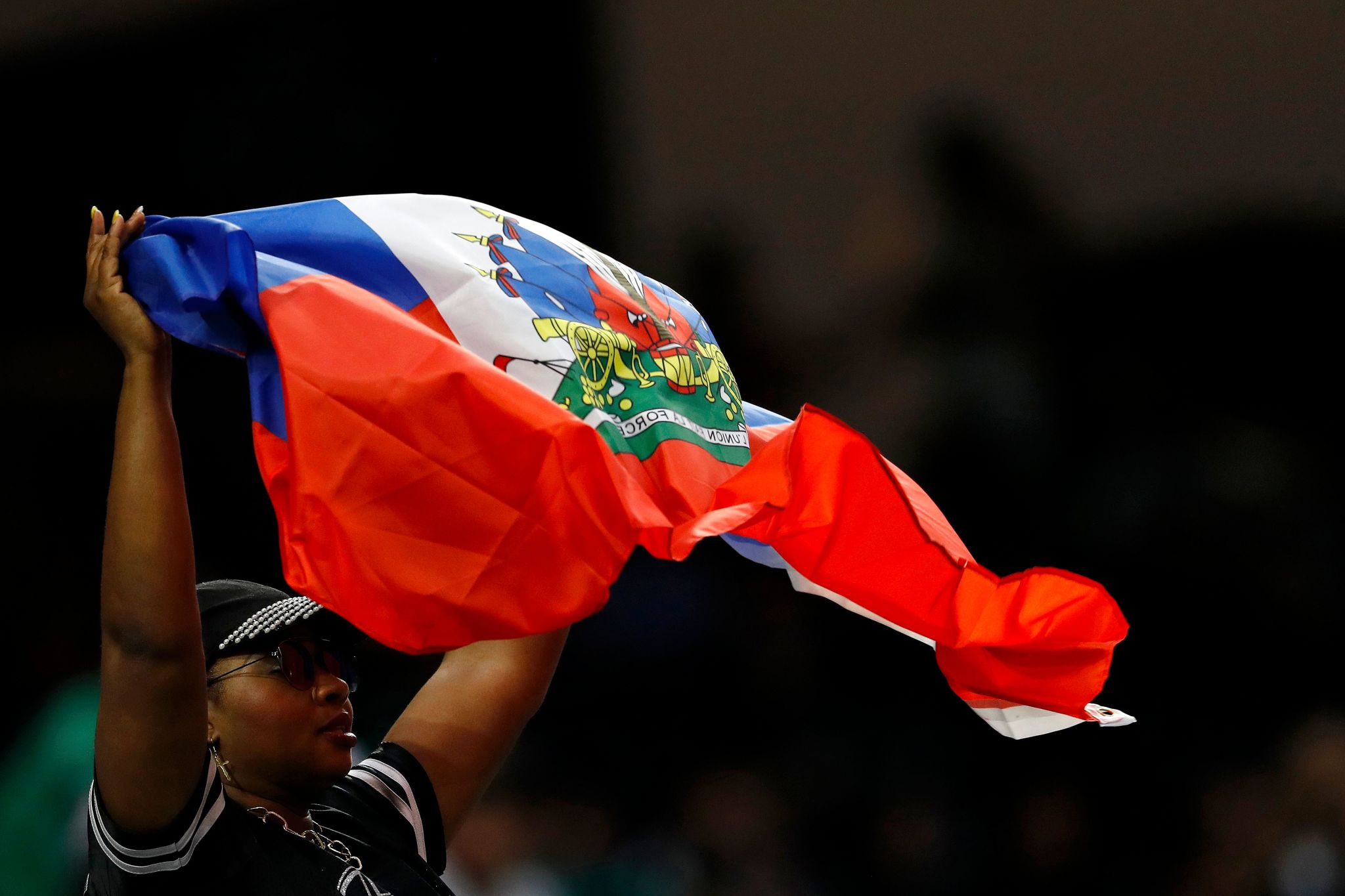 A <HIT>Haiti</HIT> fans cheers on her team during the CONCACAF Gold Cup Quarterfinal football match between <HIT>Haiti</HIT> and Canada on June 29, 2019 at NRG Stadium in Houston, Texas. (Photo by AARON M. SPRECHER / AFP)