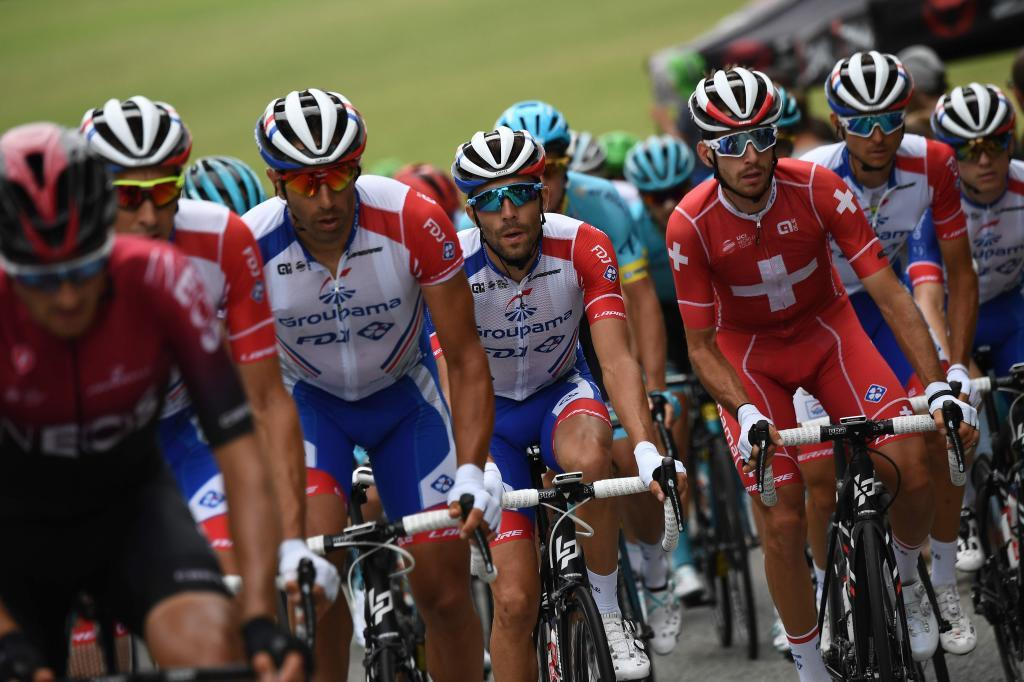 <HIT>France</HIT>s Thibaut Pinot (C) rides in the pack during the seventh stage of the 106th edition of the <HIT>Tour</HIT> de <HIT>France</HIT> cycling race between Belfort and Chalon-sur-Saone, on July 12, 2019. (Photo by Anne-Christine POUJOULAT / AFP)