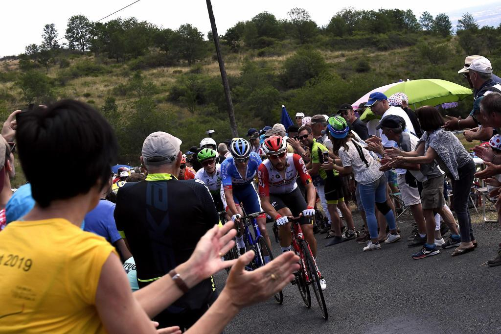 (FromFront) Belgiums Thomas De <HIT>Gendt</HIT>, Netherlands Niki Terpstra, US Benjamin King and Italys Alessandro De Marchi ride in a breakaway cheered by fans during the eighth stage of the 106th edition of the Tour de France cycling race between Macon and Saint-Etienne, on July 13, 2019. (Photo by JEFF PACHOUD / AFP)