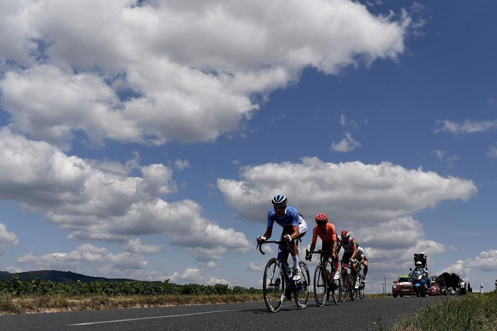 TOPSHOT - Cyclists ride in the countryside during the eighth stage of the 106th edition of the <HIT>Tour</HIT> de France cycling race between Macon and Saint-Etienne, on July 13, 2019. (Photo by JEFF PACHOUD / AFP)