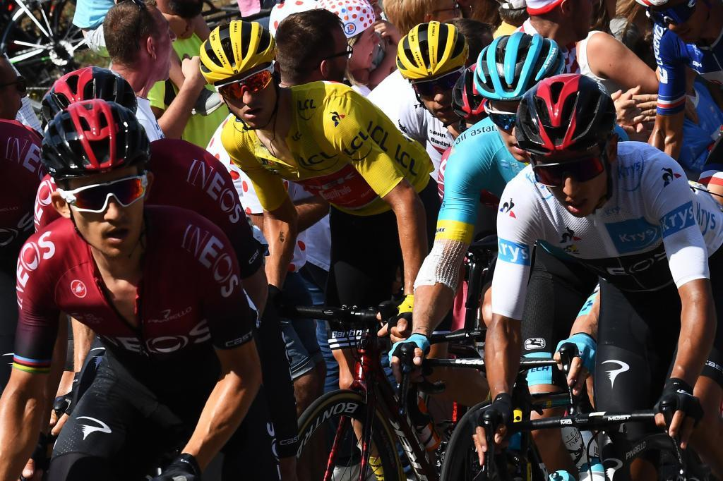 (FromL) Polands Michal Kwiatkowski, Colombias Egan Bernal, wearing the best youngs white jersey and Italys Giulio Ciccone (C), wearing the overall leaders yellow jersey ride in the pack during the eighth stage of the 106th edition of the <HIT>Tour</HIT> de France cycling race between Macon and Saint-Etienne, on July 13, 2019. (Photo by Anne-Christine POUJOULAT / AFP)