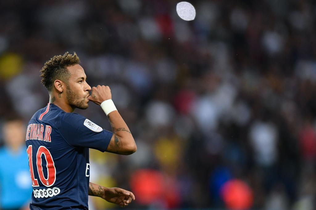 TOPSHOT - Paris Saint-Germains Brazilian forward <HIT>Neymar</HIT> gestures as he celebrates after scoring a goal during the French L1 football match between Paris Saint-Germain and Caen on August 12, 2018 at the Parc des Princes, in Paris. (Photo by Christophe ARCHAMBAULT / AFP)