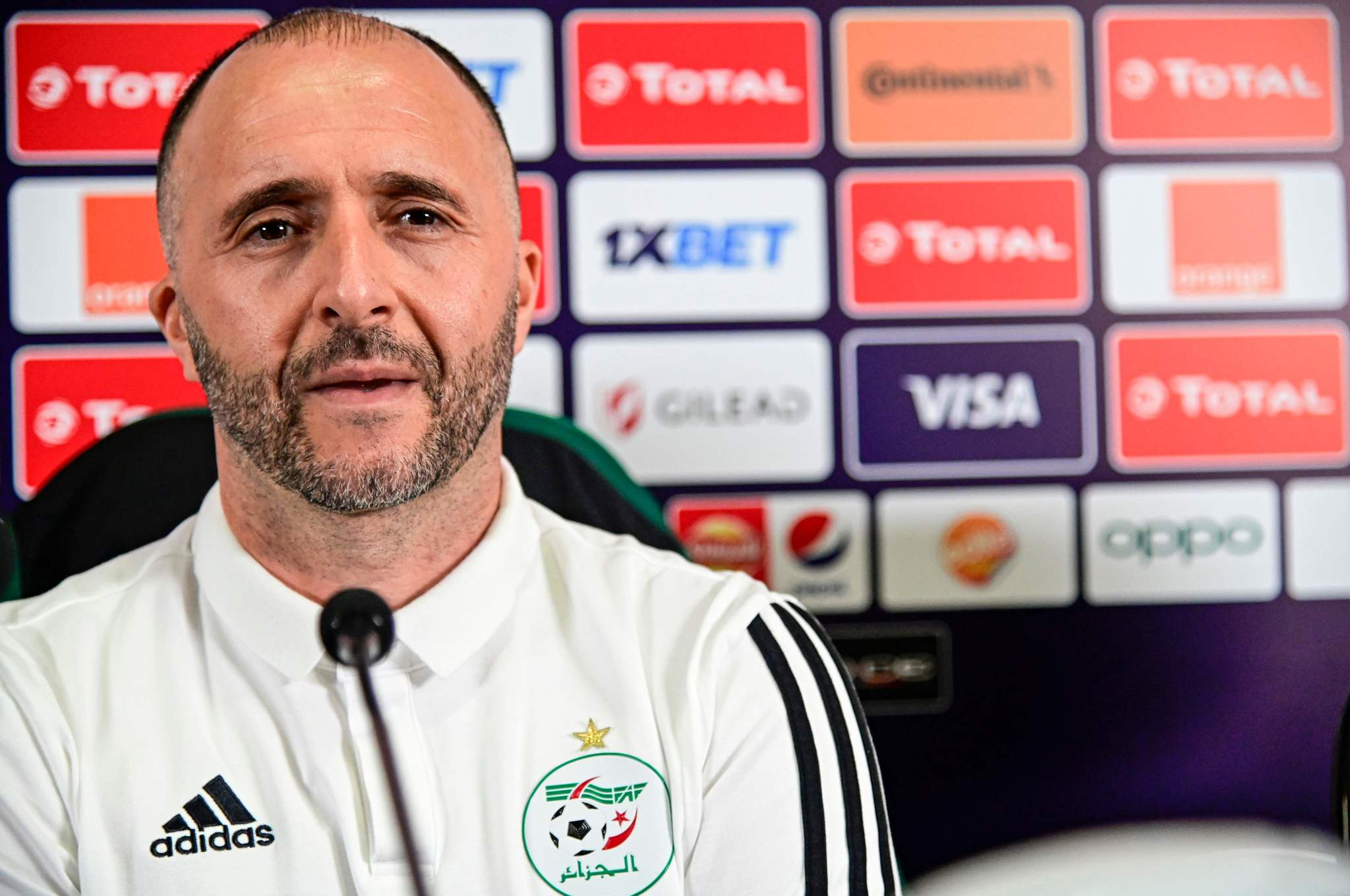 Algerias coach Djamel <HIT>Belmadi</HIT> attends a press conference at the International Cairo Stadium on July 18, 2019, on the eve of the 2019 Africa Cup of Nations (CAN) final football match between Senegal and Algeria. (Photo by JAVIER SORIANO / AFP)