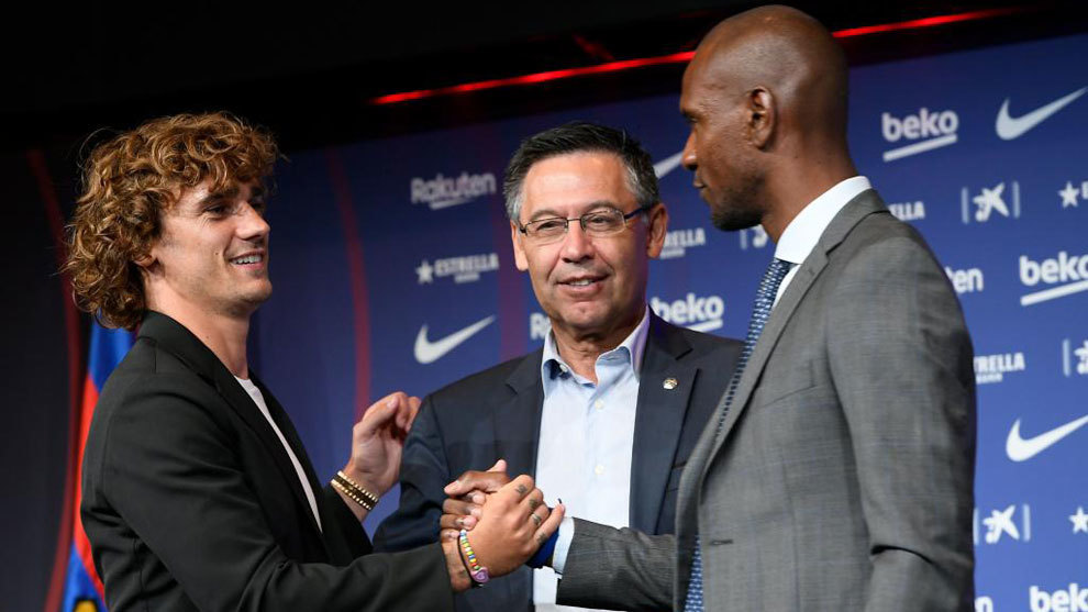 Abidal greets Griezmann during the player's presentation.