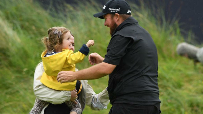 Shane Lowry embraces his family after his victory.