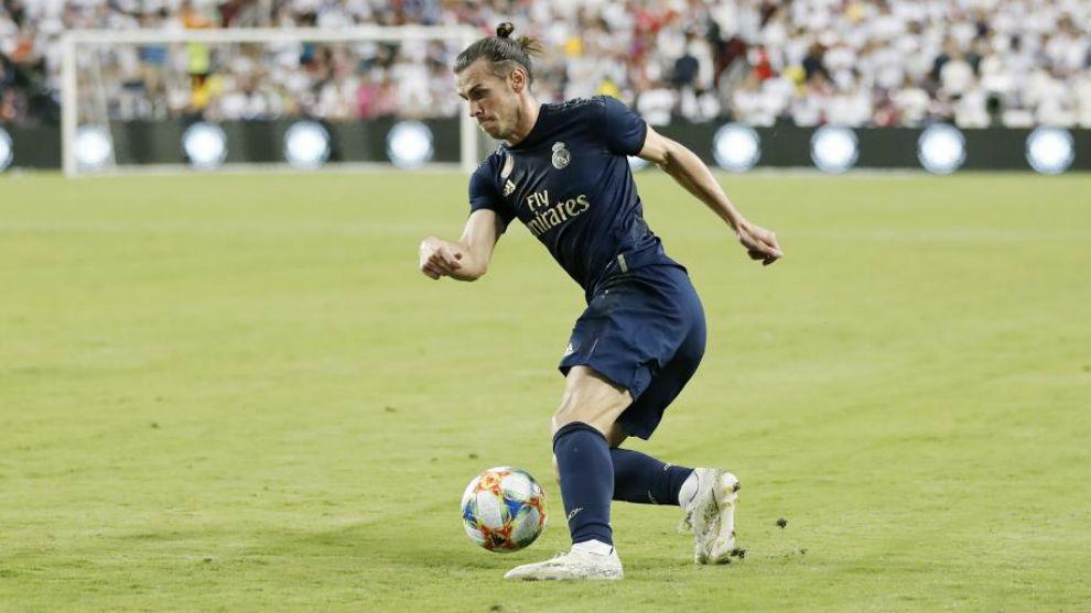 Bale hace un recorte en el partido ante el Arsenal en Washington.