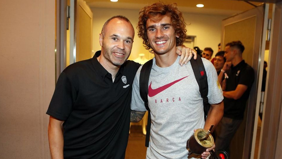 Andres Iniesta with Antoine Griezmann.