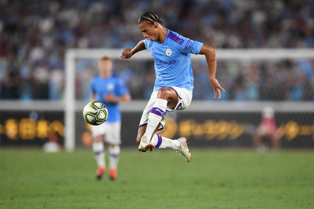 Manchester Citys midfielder Leroy <HIT>Sane</HIT> controls the ball during a friendly football match between English Premier League club Manchester City and Japan League Yokohama F. Marinos at the Yokohama Stadium, in Yokohama on July 27, 2019. (Photo by CHARLY TRIBALLEAU / AFP)
