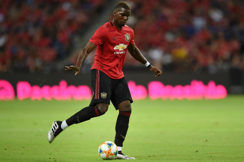 Manchester Uniteds Paul <HIT>Pogba</HIT> prepares to strike the ball during the International Champions Cup football match between Manchester United and Inter Milan in Singapore on July 20, 2019. (Photo by Roslan RAHMAN / AFP)