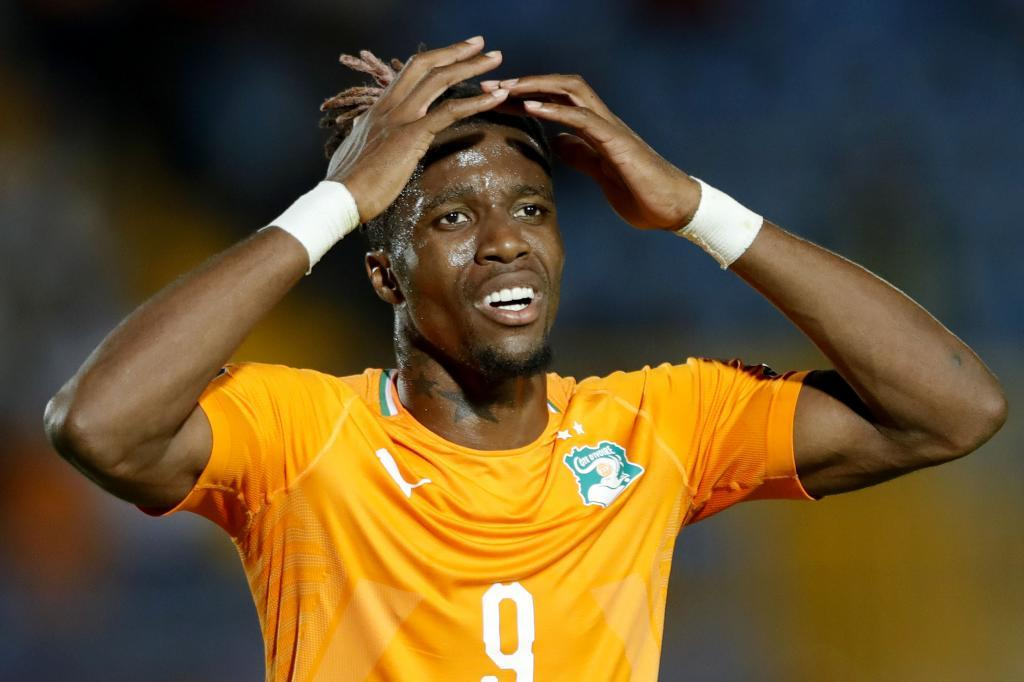 Ivory Coasts forward Wilfried <HIT>Zaha</HIT> reacts during the 2019 Africa Cup of Nations (CAN) quarter final football match between Ivory Coast and Algeria at the Suez stadium in Suez on July 11, 2019. (Photo by FADEL SENNA / AFP)