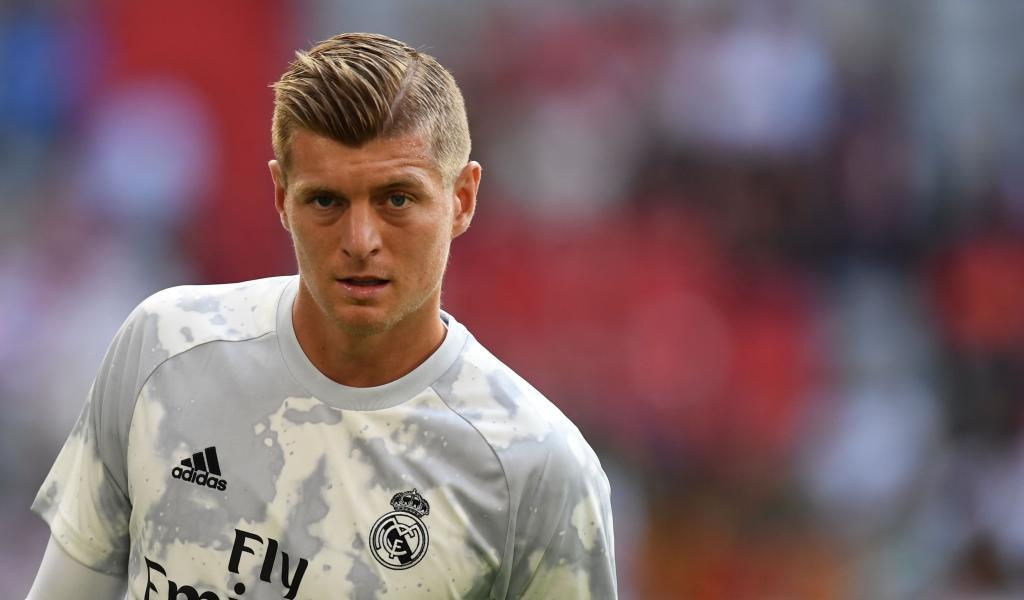 Real Madrids German midfielder Toni <HIT>Kroos</HIT> warms up prior to the Audi Cup football match between Real Madrid and Tottenham Hotspur in Munich, southern Germany, on July 30, 2019. (Photo by Christof STACHE / AFP)