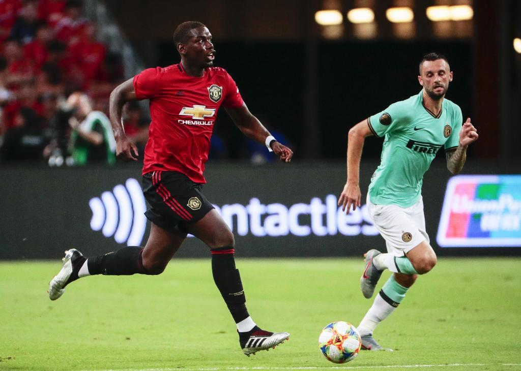Singapore (Singapore), 20/07/2019.- Manchester Uniteds Paul <HIT>Pogba</HIT> (L) in action against Inters Marcelo Brozovic (R) during the International Champions Cup soccer match between Manchester United and Inter Milan at the National Stadium in Singapore, 20 July 2019. (Singapur, Singapur) EFE/EPA/WALLACE WOON