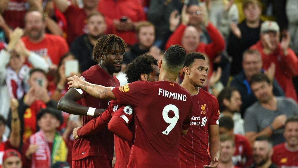 Los jugadores del Liverpool celebran uno de los goles del partido.