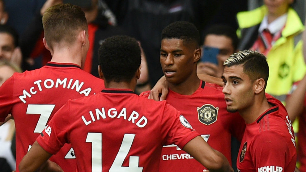 The Manchester United players celebrate one of Marcus Rashford's...