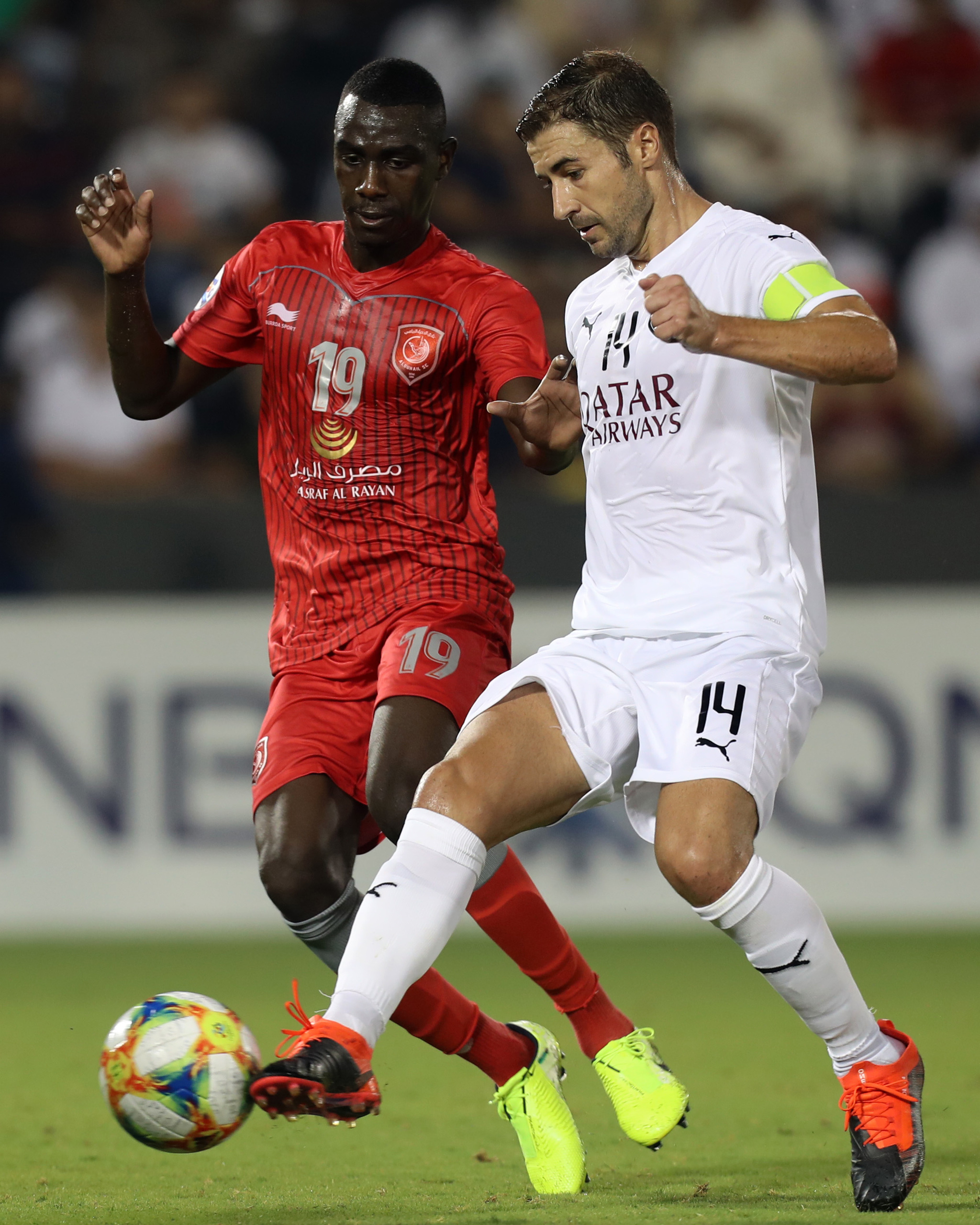 Sadd SCs Spanish midfielder <HIT>Gabi</HIT> (R) and Duhail SCs Qatari forward Almoez Ali vie for the ball during the AFC Champions League round of 16 second leg football match between Qatars al-Sadd and Qatars al-Duhail at Jassim bin Hamad stadium in Doha on August 13, 2019. (Photo by KARIM JAAFAR / AFP)
