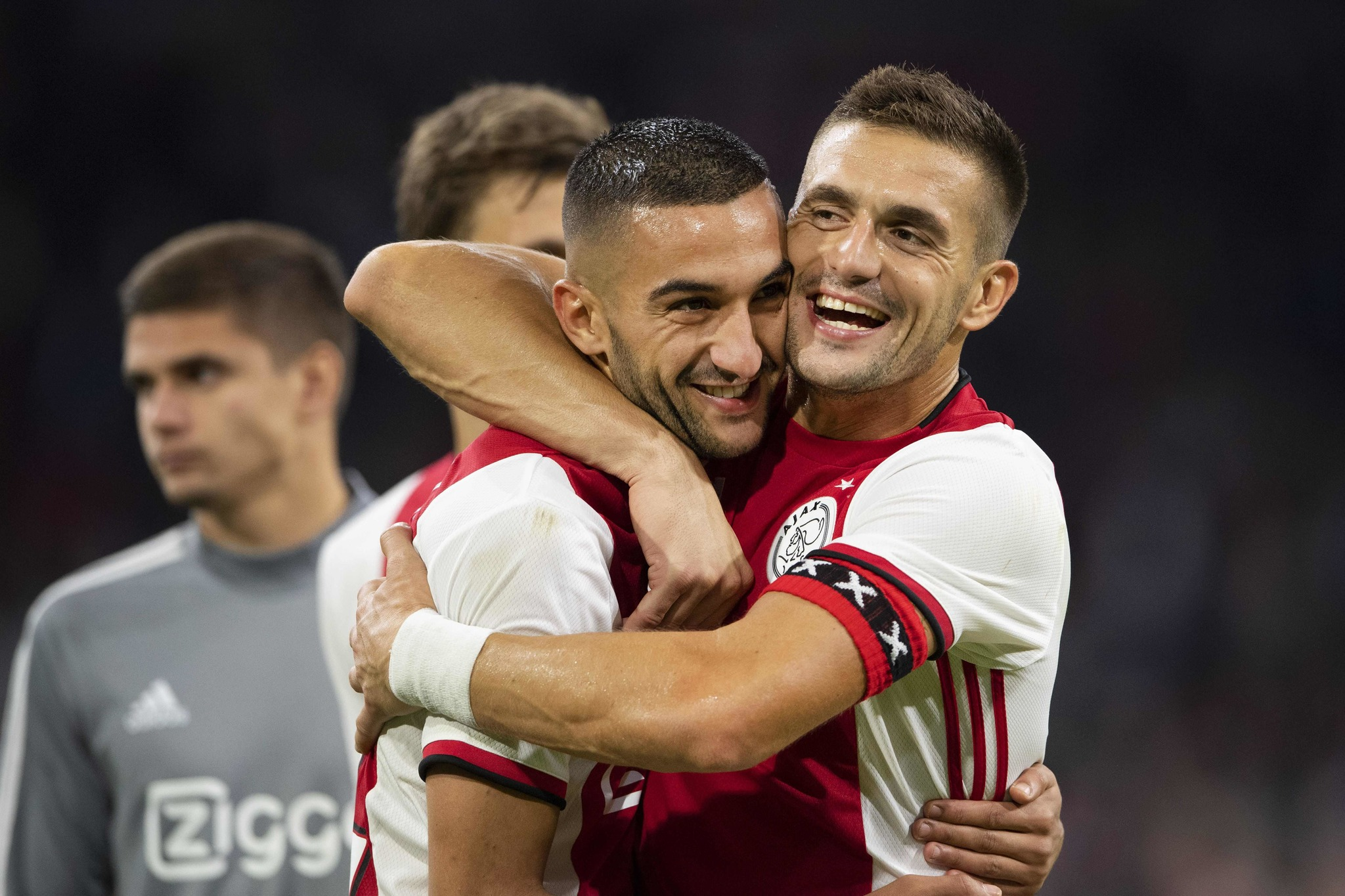 Ajax Amsterdams Serbian forward Dusan <HIT>Tadic</HIT> (R) and Ajax Amsterdams Moroccan midfielder Hakim Ziyech celebrate after winning the UEFA Champions League third preliminary round football match between Ajax Amsterdam and PAOK Saloniki, on August 13, 2019 in Amsterdam, The Netherlands. (Photo by Olaf KRAAK / ANP / AFP) / Netherlands OUT