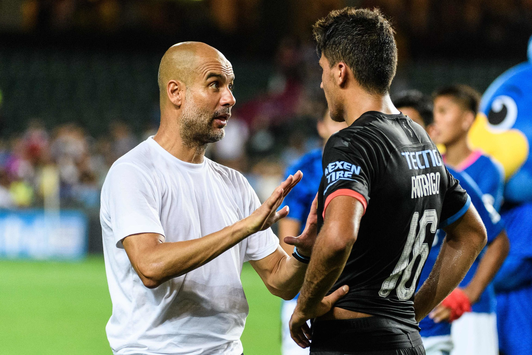 Manchester <HIT>City</HIT>s Spanish head-coach Pep Guardiola (L) speaks to teamplayer Spanish midfielder <HIT>Rodri</HIT> at the end of the friendly football match between English Premier League club Manchester <HIT>City</HIT> and Hong Kongs Kitchee at the Hong Kong Stadium, in Hong Kong on July 24, 2019. (Photo by Anthony WALLACE / AFP)