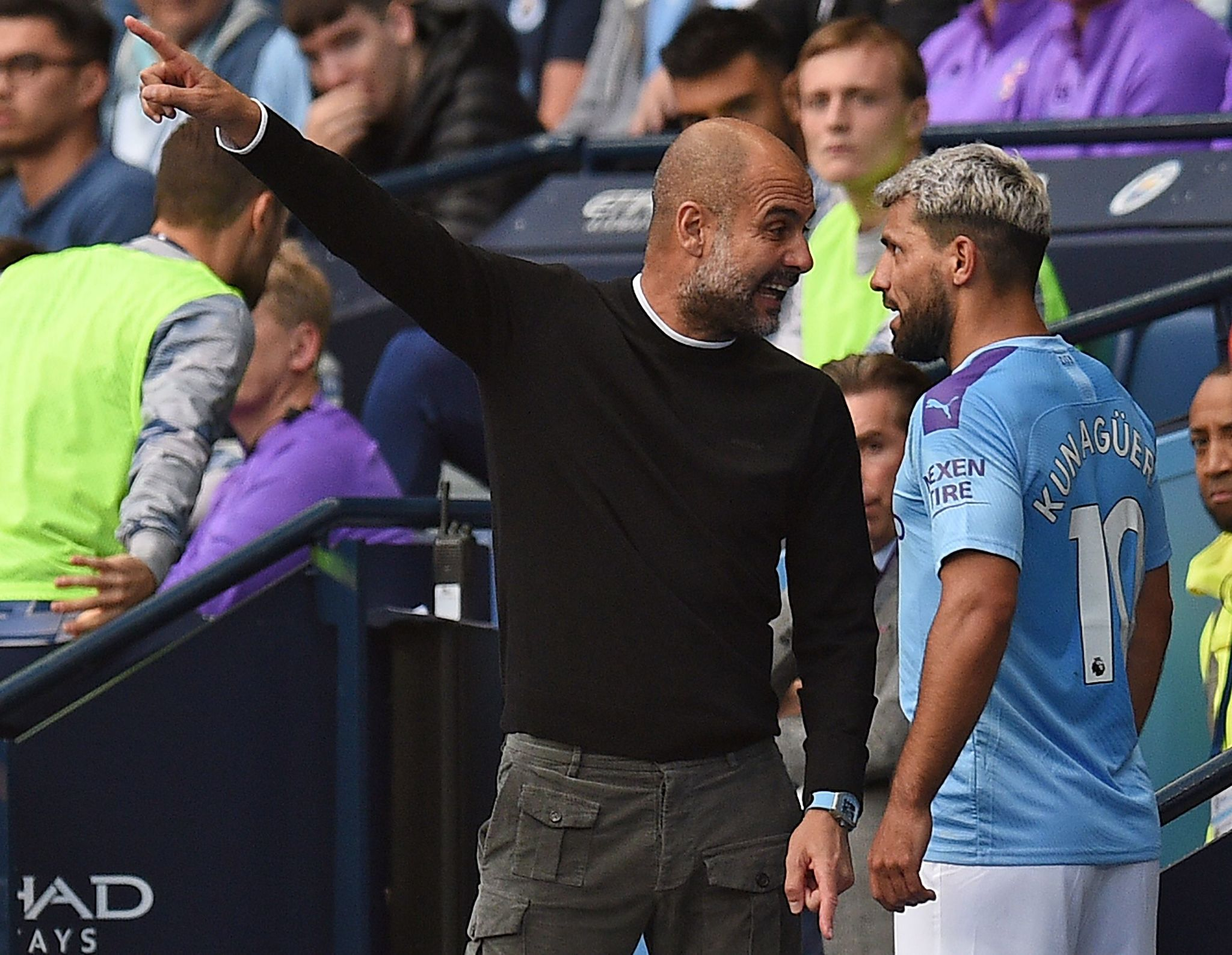 Manchester Citys Argentinian striker Sergio <HIT>Aguero</HIT> (R) talks with Manchester Citys Spanish manager Pep Guardiola as he is substitued off during the English Premier League football match between Manchester City and Tottenham Hotspur at the Etihad Stadium in Manchester, north west England, on August 17, 2019. (Photo by Oli SCARFF / AFP) / RESTRICTED TO EDITORIAL USE. No use with unauthorized audio, video, data, fixture lists, club/league logos or live services. Online in-match use limited to 120 images. An additional 40 images may be used in extra time. No video emulation. Social media in-match use limited to 120 images. An additional 40 images may be used in extra time. No use in betting publications, games or single club/league/player publications. /