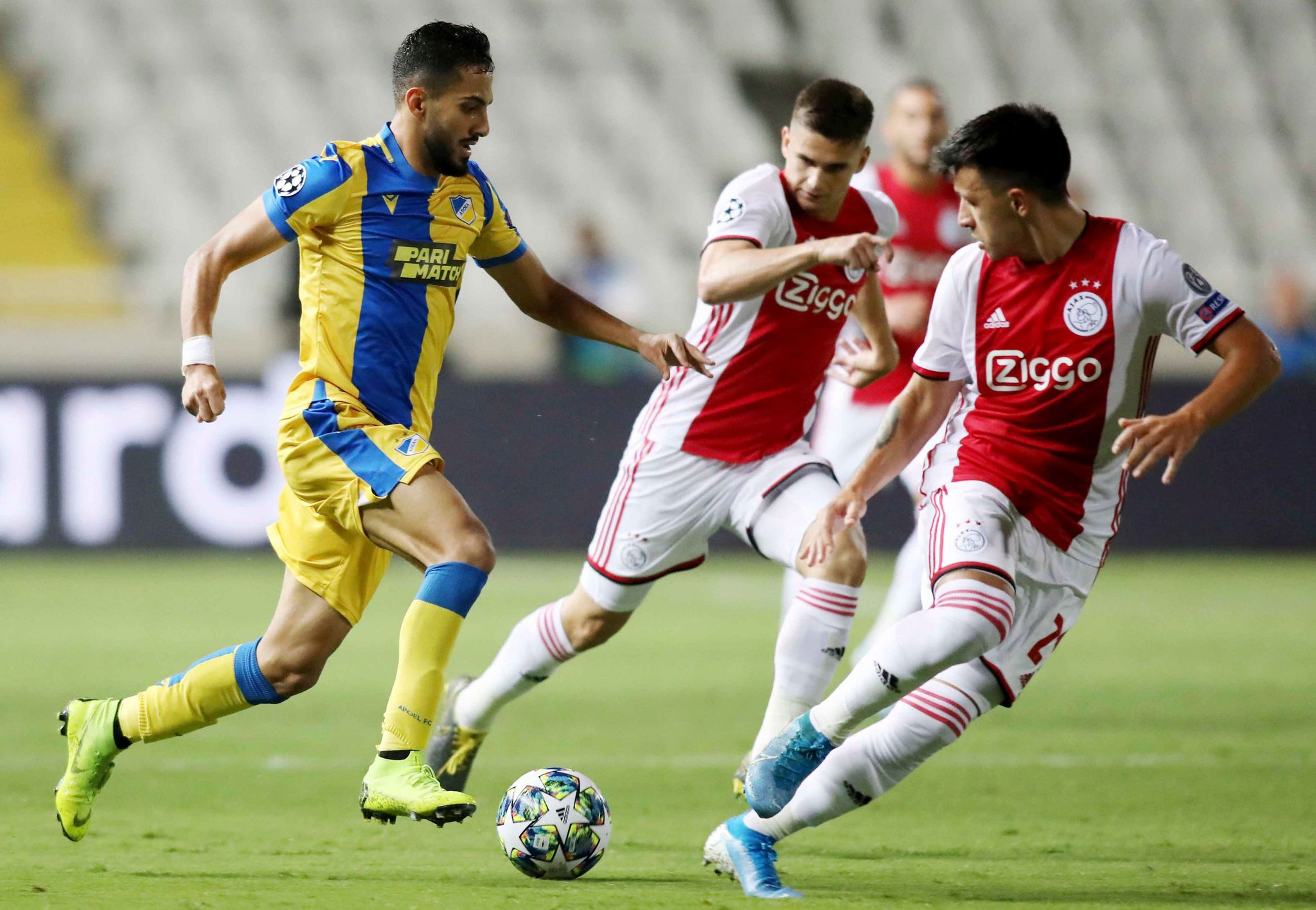 APOELs midfielder Musa Suliman (L) is marked by <HIT>Ajax</HIT>s defender Lisandro Martinez (R) during the UEFA Champions League playoff football match between Cyprus APOEL Nicosia and Netherlands <HIT>Ajax</HIT> Amsterdam at the GSP stadium in Nicosia on August 20, 2019. (Photo by - / AFP)