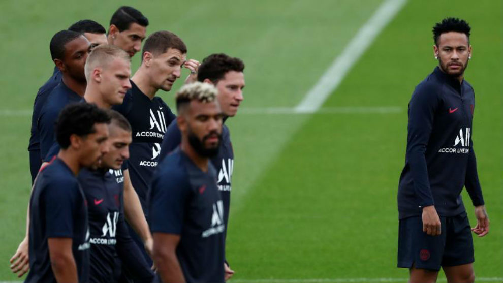 Neymar looking at his Paris Saint-Germain teammates during a training...