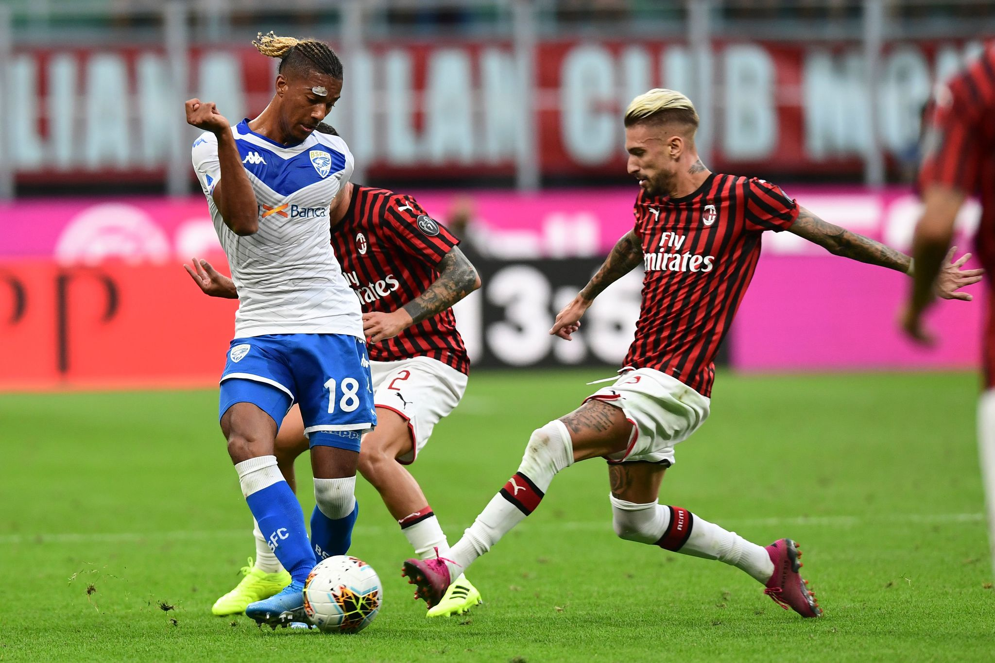 Brescias French forward Florian Aye vies with AC <HIT>Milan</HIT>s Spanish forward Samu Castillejo during the Italian Serie A football match AC <HIT>Milan</HIT> vs Brescia on August 31, 2019 at the San Siro stadium in <HIT>Milan</HIT>. (Photo by Miguel MEDINA / AFP)